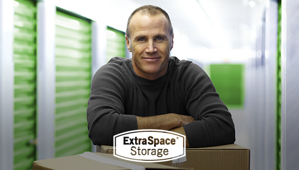 Man in front of storage containers