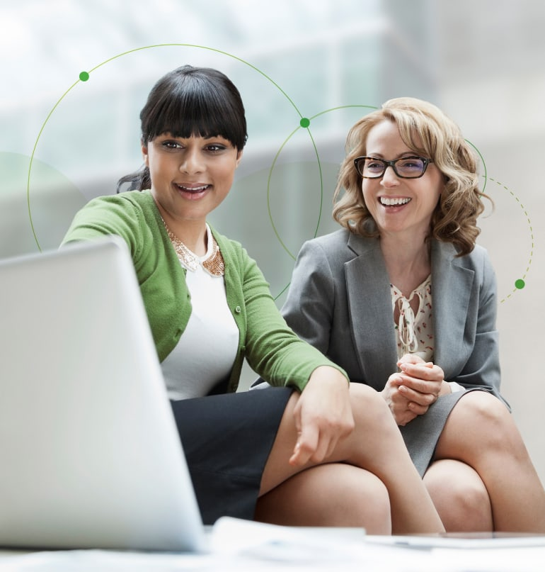 Two women in front of a computer with text 'the AI advantage: a guide to a smarter recruitment strategy' above them