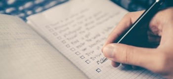 Person writing a checklist