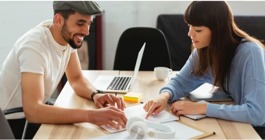 Two people working on a project