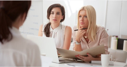 Two women interviewing someone