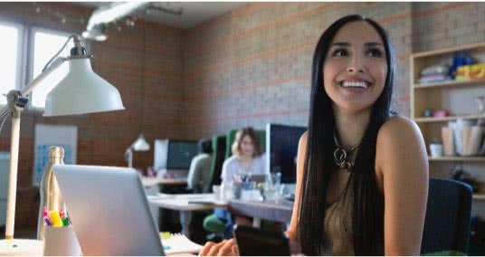 Girl smiling from her desk