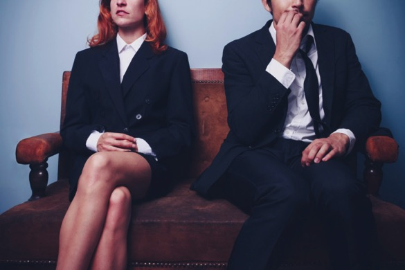 A Mmn and a woman waiting for a job interview