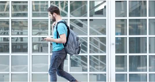 Guy in backpack walking